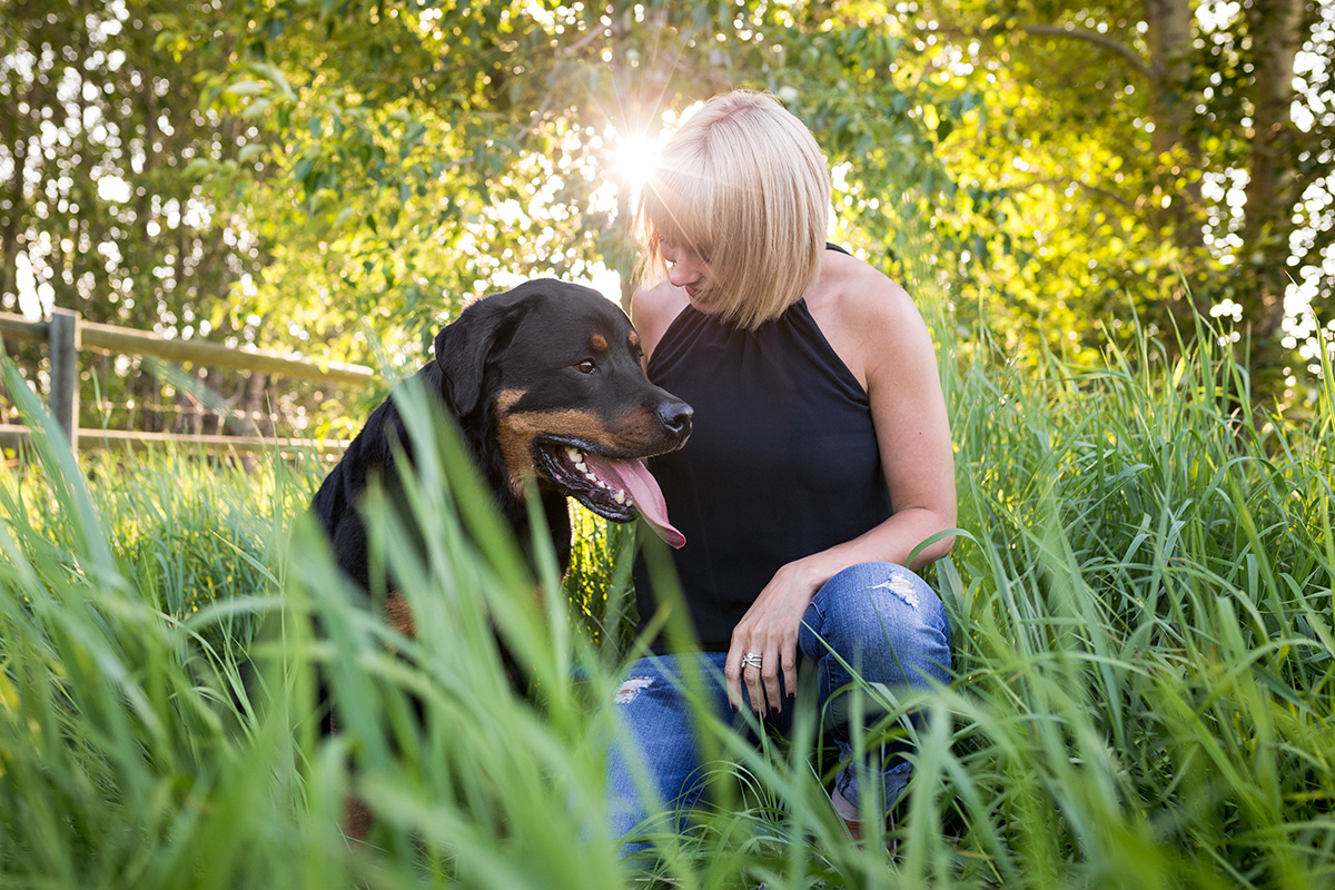 Blond lady with rotti